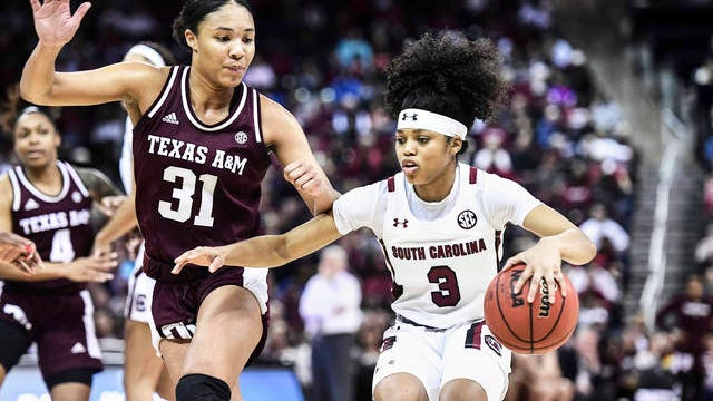 South Carolina guard Destanni Henderson (3) dribbles against Texas A&M forward N'dea Jones (31) during the second half of an NCAA college basketball game Sunday in Columbia, S.C. South Carolina defeated Texas A&M 60-52.