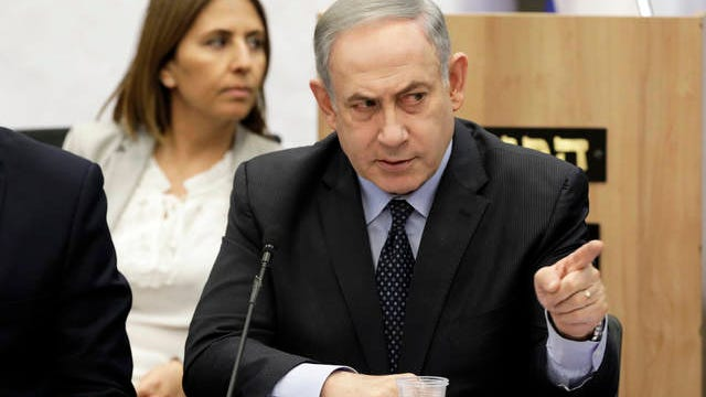 Israeli Prime Minister Benjamin Netanyahu gestures during a meeting with his nationalist allies and his Likud party members at the Knesset, Israeli Parliament, in Jerusalem on Wednesday.