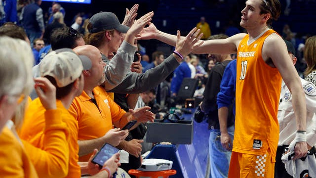 John Fulkerson celebrates with Tennessee fans that made the trip Tuesday night to Lexington. Fulkerson scored a career-high 27 points, the second-most by a UT player at Rupp Arena, in an 81-73 victory.