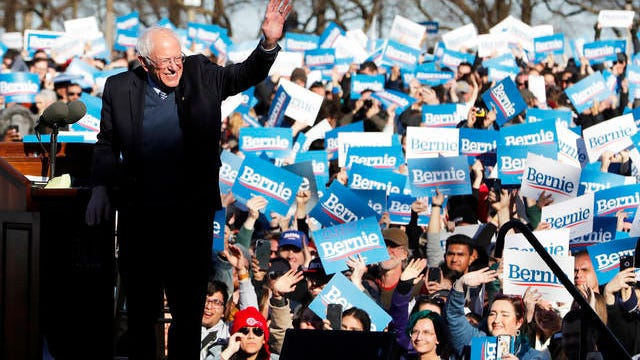 Democratic presidential candidate Sen. Bernie Sanders, I-Vt., waves to supporters after speaking at a campaign rally in Chicago's Grant Park on Saturday.