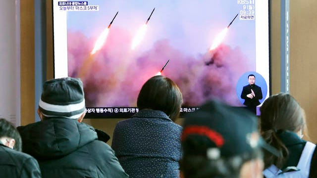 """People watch a TV showing file images of North Korea's missile launch during a news program at the Seoul Railway Station in Seoul, South Korea on Monday. North Korea fired three unidentified projectiles off its east coast on Monday, South Korea's military said, two days after the North threatened to take """"momentous"""" action to protest outside condemnation over its earlier live-fire exercises."""