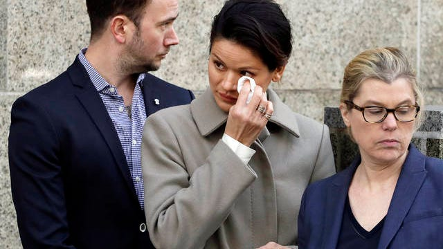 Tarale Wulff, center, wipes her eye before she speaks to the press after Harvey Weinstein's sentencing, in New York on Wednesday. Weinstein was sentenced to 23 years in prison for rape and sexual assault. During Weinstein's trial, Wulff testified that the one-time Hollywood titan raped her at his New York City apartment after luring her there in 2005 with promises of an audition for a film role.