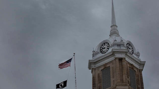 Storm clouds hang above the Maury County Courthouse clock tower on Sunday, Dec. 29, 2019.