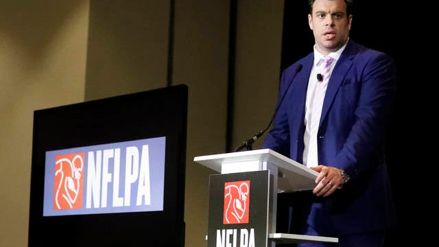 In a Jan. 30 file photo, Eric Winston, president of the NFL Players Association, speaks at the annual state of the NFLPA press conference, in Miami Beach, Fla. NFL players have approved a new labor agreement with the league that features a 17-game regular season, higher salaries, increased roster sizes and larger pensions for current and former players.