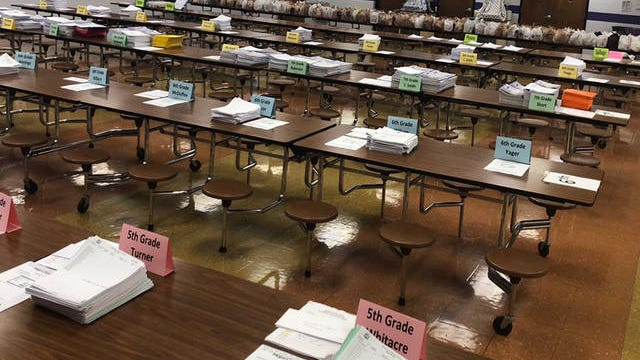 Workbooks sit ready for distribution to students at Whitthorne Middle School on the first day of a month long suspension of school on Tuesday.