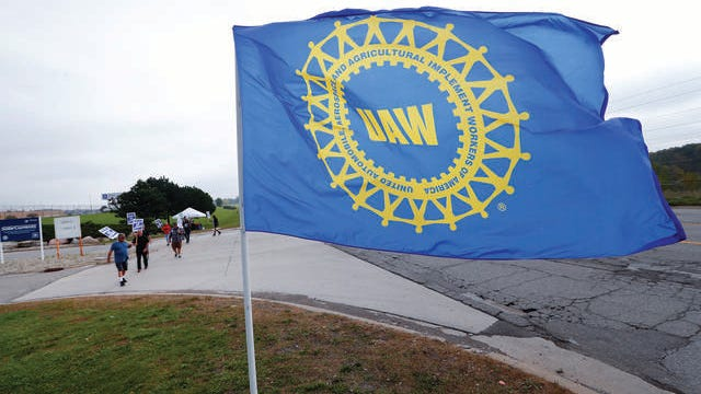 A UAW flag flies near strikers outside the General Motors Orion Assembly plant in Orion Township, Michigan.