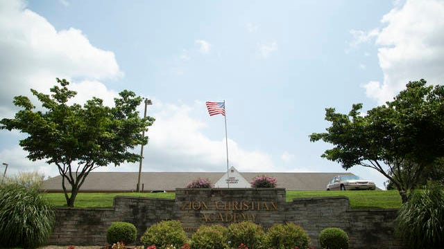 An American flag flies over the Zion Christian Academy campus in Columbia on Friday, July 20, 2018.