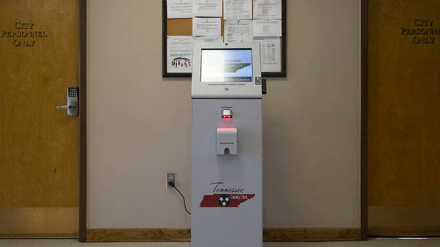 A tag renewal kiosk from the Maury County Clerk's office sits in the lobby of Mt. Pleasant City Hall.
