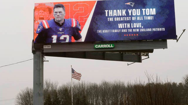 A billboard featuring an image of former New England Patriots quarterback Tom Brady stands along Route 1, in Walpole, Mass., about a mile from Gillette Stadium, which is in Foxborough, Mass. on March 19. The Kraft family and the New England Patriots signed off on a message on the sign meant to honor the quarterback. Robert Kraft is the owner of the football team. Brady said on social media on March 17 that he would not be returning to the Patriots and has become a free agent.