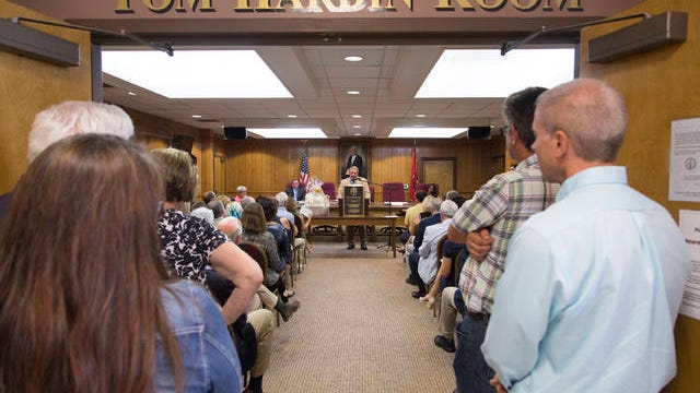 Community members filled the Mt. Pleasant City Hall commission chambers as the room was dedicated in honor of longtime city attorney Tom Hardin on Tuesday, June 20, 2017.