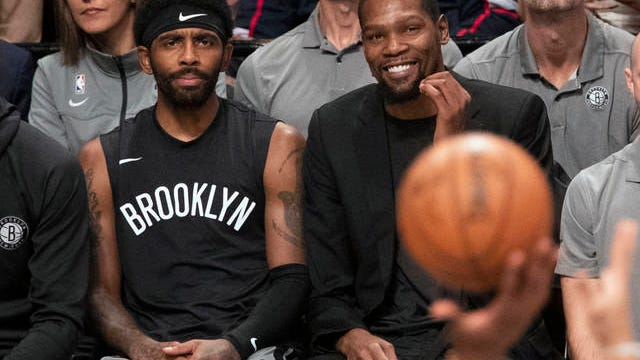 Kevin Durant (right) was expected to miss the entire 2019-20 season for the Brooklyn Nets after rupturing his Achilles tendon during last year's NBA Finals. With the pause in the schedule caused by the coronavirus pandemic, though, team officials are not ruling out his or Kyrie Irving's return, the latter from shoulder surgery last month.