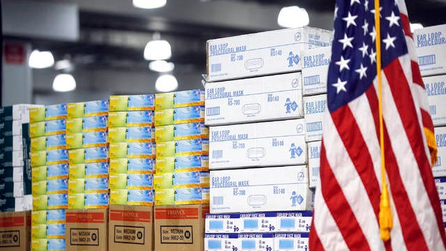 In this March 24 file photo, stacks of medical supplies are housed at the Jacob Javits Center that will become a temporary hospital in response to the COVID-19 outbreak in New York. A review of federal purchasing contracts by The Associated Press shows federal agencies waited until mid-March to begin placing bulk orders of N95 respirator masks, mechanical ventilators and other equipment needed by front-line health care workers.