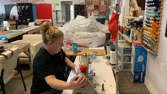 Cori Johnson, a seamstress with SoftSpace, a Columbia-based design and fabrication company, sews masks for medical workers.