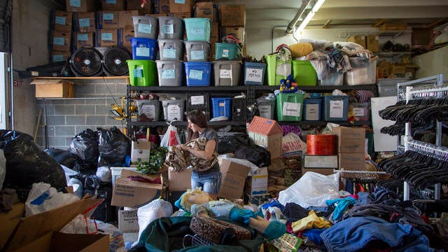 Common Threads Assistant Manager Shannon Stematis sorts though donated items in the back room of the Columbia Thrift shop on Aug. 20, 2019. The local shop, which funds local support organization the Family Center of Columbia, is struggling to store and sell all of the donations it receives.