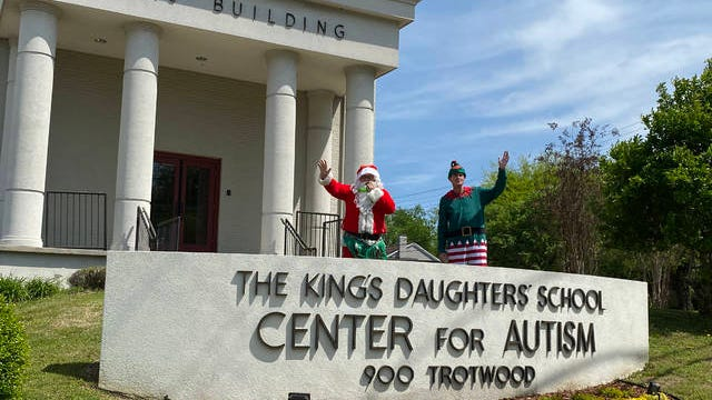 Residential Director Landon White and Clinical Director David Craig dressed as Santa and his handy helper as they and the rest of the staff, also in costume, handed out surprise gifts to their students at King's Daughters' School on Friday.