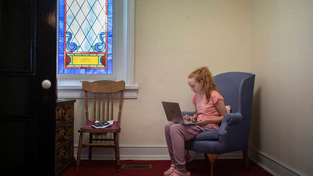 Sage Arnold, 12, a student at Santa Fe Unit School in Maury County, continues her studies inside a back room at Franklin Cumberland Presbyterian Church in Williamson County on Wednesday. Without access to the internet at her northern Maury County home, the family visits the church on a regular basis to remain connected to her teachers amid the school closure due to the coronavirus.