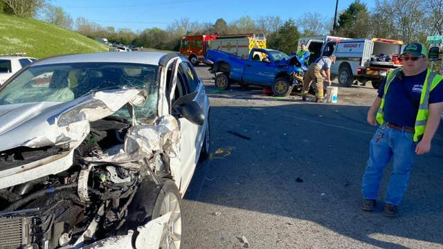 Maury County firefighters respond to a head-on collision on New Lewisburg Highway on Tuesday.