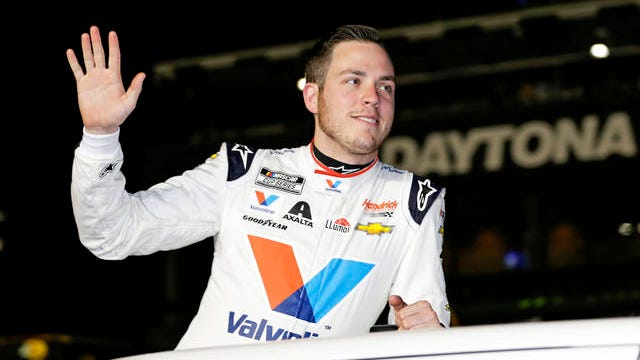 Alex Bowman waves to fans during driver introductions before the first of two Daytona 500 qualifying auto races at Daytona International Speedway on Feb. 13 in Daytona Beach, Fla.
