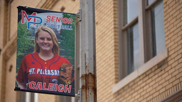 A banner celebrating Mt. Pleasant High School senior softball player Caleigh Smith hangs along North Main Street in downtown Mt. Pleasant on Friday.