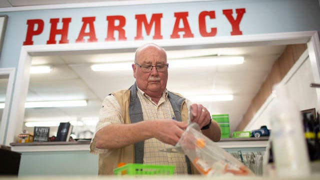 Kenneth Lovett, a retired Columbia police officer, prepares prescriptions for delivery at Kinzer Pharmacy and Wellness in Mt. Pleasant on Friday. The locally owned pharmacy began offering a delivery service amid the outbreak of coronavirus in Tennessee.