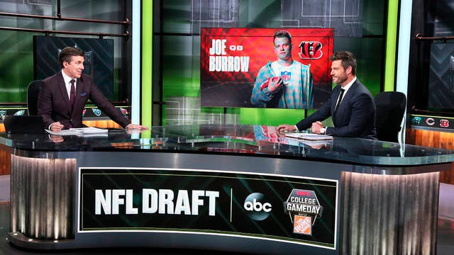 In a photo provided by ESPN Images, Rece Davis, left, and Jesse Palmer discuss the NFL football draft on April 23 in Bristol, Conn.