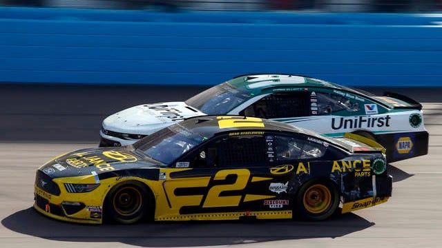 Brad Keselowski (2) races Chase Elliott (9) through Turn 4 during the NASCAR Cup Series auto race at Phoenix Raceway, March 8, in Avondale, Ariz.