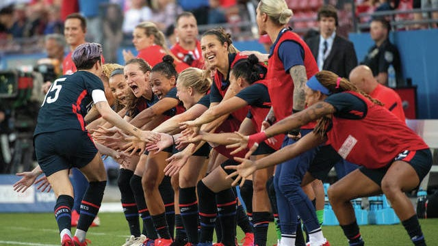 United States forward Megan Rapinoe (15) celebrates with teammates after scoring on a free kick against Japan during the first half of a SheBelieves Cup women's soccer match March 11 in Frisco, Texas.