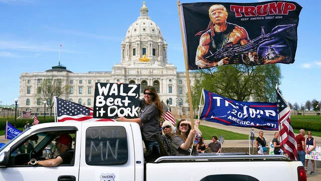 """Supporters of President Donald Trump circle the State Capitol as they protest Gov. Tim Walz's """"Stay Home MN"""" orders meant to slow the spread of COVID-19 on Saturday in St. Paul, Minn."""
