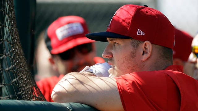 Los Angeles Angels' Mike Trout watches batting practice during spring training baseball practice Monday in Tempe, Ariz.