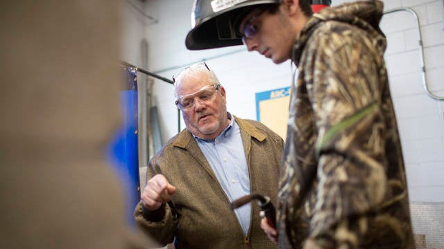 BMC Metalworks Operations Manager Howard Graves works with Mt. Pleasant High School student Collyn Forshee, 17, during a welding certification class at the high school on Thursday, Nov. 7, 2019.
