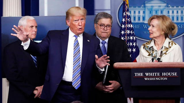 President Donald Trump gestures as he asks a question to Dr. Deborah Birx, White House coronavirus response coordinator, during a briefing about the coronavirus in the James Brady Briefing Room on March 23 in Washington.