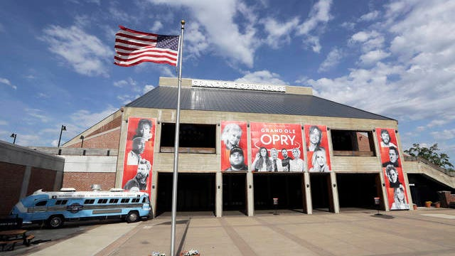 This April 28 photo shows the Grand Ole Opry House in Nashville. The Opry has suspended all events through May 16 due to the coronavirus pandemic. As businesses start to gradually reopen across the state, Tennessee tourism destinations like the Grand Ole Opry, Graceland and Dollywood remain closed. But many of them are preparing to start welcoming visitors once again in a state where tourists spent $22 billion in 2018.