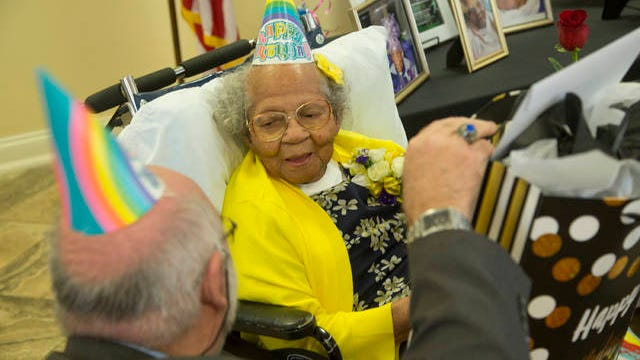 Life Care Center of Columbia Executive Director Mark King speaks with 104-year-old resident Lilli Sewell during a special celebration on Friday, April 20, 2018.