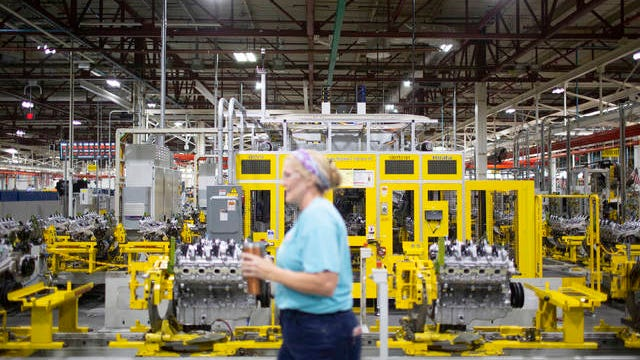 General Motors employee Robin Leavitt walks along the Global Propulsion Systems assembly line inside the Spring Hill manufacturing facility on Thursday, Jan. 16, 2020.