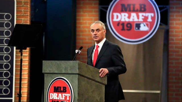 Major League Baseball commissioner Rob Manfred speaks during the first round of the Major League Baseball draft, on June 3, 2019 in Secaucus, N.J.