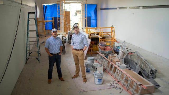 Owners Andy Kenney and Cory Muehlbauer stand inside what will be the newly renovated home of Southern Exposure, an outdoor apparel store located in downtown Columbia, on April 28. The store flooded due to a broken sprinkler in June 2019 and is planned to reopen this summer following an extensive renovation.