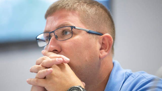 MCPS school board member Chad Howell listens to comments from the public during a meeting at Horace O. Porter School on Sept. 9, 2019.