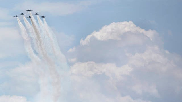 """The Blue Angels fly over Nashville, Tenn., on Thursday, May 14, 2020. The show was held as part of """"Operation America Strong,"""" a collective salute to frontline medical workers, first responders and other essential workers."""