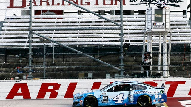 Kevin Harvick (4) crosses the finish line to win the NASCAR Cup Series auto race Sunday in Darlington, S.C.
