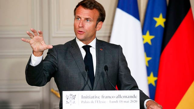 French President Emmanuel Macron speaks during a joint video press conference with German Chancellor Angela Merkel at the Elysee Palace Monday in Paris. France and Germany discussed Europe's economic recovery plans to respond to the virus crisis.