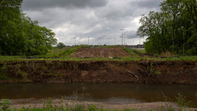 The site of a planned bridge connecting Battle Creek Middle Elementary School and Battle Creek Elementary School over Rutherford Creek in Spring Hill has been cleared sits cleared of trees and brush and ready for construction to begin on Wednesday, May, 20, 2020.