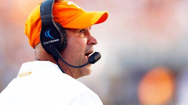 Tennessee football coach Jeremy Pruitt walks the sidelines last season.