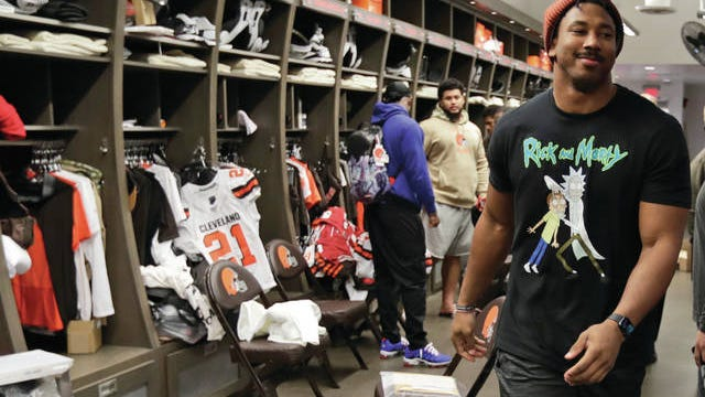 In this Dec. 30 file photo Cleveland Browns defensive end Myles Garrett walks through the locker room at the NFL football team's training camp facility in Berea, Ohio. The NFL is taking baby steps toward full reopenings for its teams. It has no other choice. Consider social distancing. This could be the most difficult task of all.