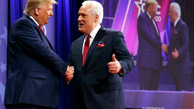 """In this Feb. 29 file photo, President Donald Trump is greeted by Matt Schlapp, Chairman of the American Conservative Union, as the president arrives to speak at the Conservative Political Action Conference, at National Harbor, in Oxon Hill, Md. Republican political operatives are recruiting """"pro-Trump"""" doctors to go on television to prescribe reviving the U.S. economy as quickly as possible, without waiting to meet the COVID-19 safety benchmarks proposed by public health experts."""