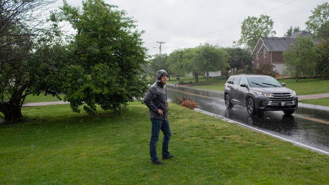 Dave Bechtel, a resident of Stewart Campbell Pointe in Spring Hill, watches as cars pass a set of newly installed chicanes in front of his home on Wednesday. Bechtel and other neighbors say the minor barrieres have done little to slow drivers that speed on the residential road.