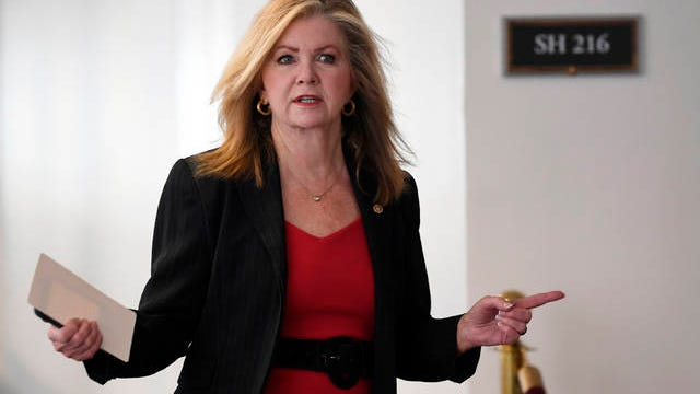 Sen. Marsha Blackburn, R-Tenn., heads into a Republican policy lunch on Capitol Hill in Washington, March 19.
