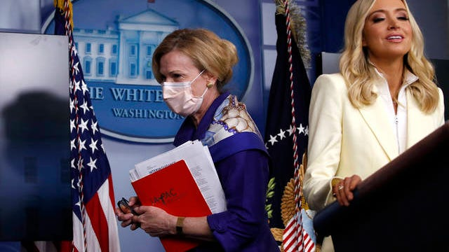 Dr. Deborah Birx, White House coronavirus response coordinator, leaves after speaking with reporters about the coronavirus in the James Brady Briefing Room of the White House, Friday, in Washington, as White House press secretary Kayleigh McEnany talks at the podium.