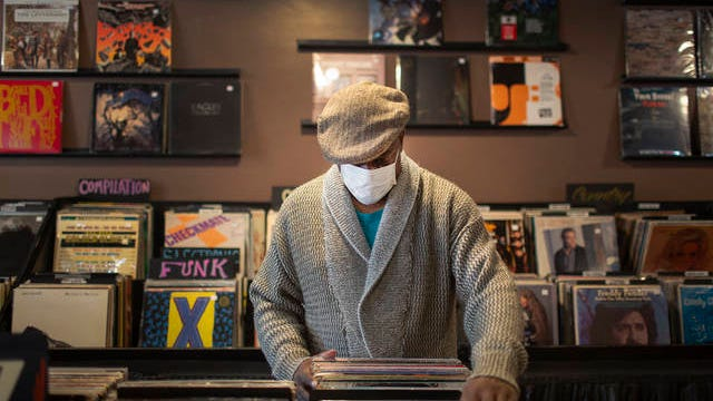 David Jackson wears a mask as he shops at the Variety Record Shop in downtown Columbia on Wednesday, May 6, 2020, days retail establishments were allowed to reopen following a state-wide shutdown to prevent the spread of the coronavirus.