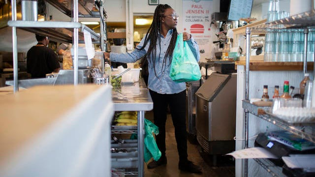 Timesha Brown prepares a meal for takeout at the Dotted Lime in Columbia on on Tuesday, May 12, 2020. The restaurant continued to offer takeout options as all dining rooms were mandated to close in an effort to prevent the spread of the coronavirus.