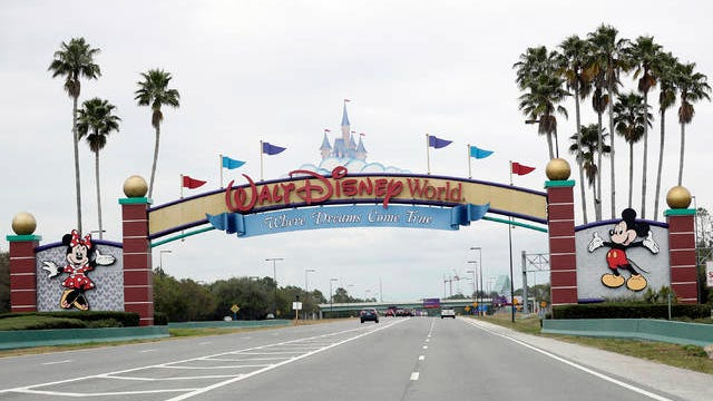 The road to the entrance of Walt Disney World has few cars Monday, March 16, in Lake Buena Vista, Fla. The Magic Kingdom, Epcot and Hollywood Studios were closed along with other theme parks around the state to help curb the spread of the coronavirus. Walt Disney World plans a tiered reopening starting in July.